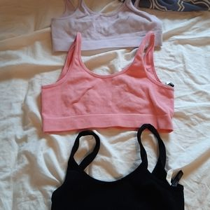 3 sports bras and 2 see through bras